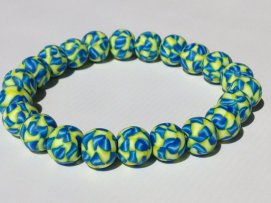 Shaded Blue & Yellow https://www.etsy.com/listing/180416502/blue-and-yellow-polymer-clay-bead?ref=shop_home_active_17