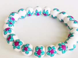 Flower Garden https://www.etsy.com/listing/155016239/polymer-clay-bead-bracelet-flower-beads?ref=shop_home_active