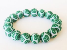 Green Glitter Swirl https://www.etsy.com/listing/165550560/polymer-clay-bead-bracelet-green-and?ref=related-2