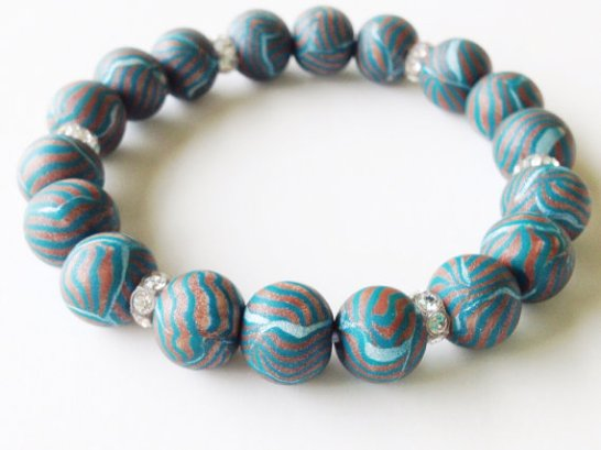 Green and Copper Striped https://www.etsy.com/listing/152264387/green-pearl-and-gold-stripes-polymer?ref=shop_home_active