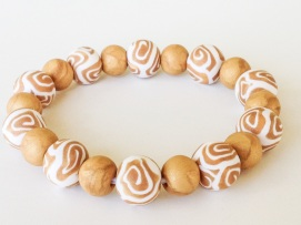 Gold Swirl https://www.etsy.com/listing/151869283/gold-and-white-polymer-clay-beads?ref=shop_home_active_6