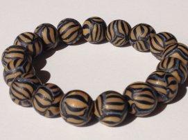 Light Gold/Black Stripedhttps://www.etsy.com/listing/169110350/polymer-clay-beads-bracelet-stripe-beads?ref=shop_home_active