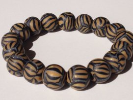 Light Gold/Black Stripedhttps://www.etsy.com/listing/169110350/polymer-clay-beads-bracelet-stripe-beads?ref=shop_home_active