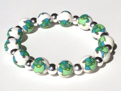 Mr. Owl https://www.etsy.com/listing/179181838/owl-polymer-clay-beads-bracelet-fimo?ref=shop_home_active_2
