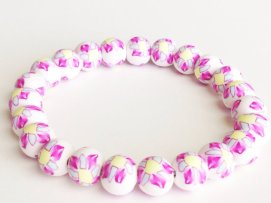 Pink Pinwheel https://www.etsy.com/listing/156895405/bracelet-polymer-clay-beads-flower-beads?ref=shop_home_active