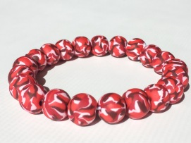 Red Camo https://www.etsy.com/listing/266192763/red-camouflage-polymer-clay-bead?ref=shop_home_active_19