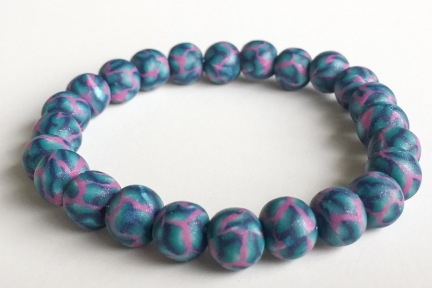Shimmery Pink & Teal https://www.etsy.com/listing/266251415/pearl-pink-teal-navy-polymer-clay-bead?ref=shop_home_active_10